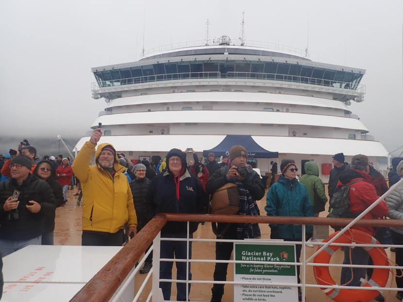 Cruise ship passengers on the forward observation deck of the Noordam vie for the best look at glaciers and whales. (Photo by Jacob Resneck/Coast Alaska)