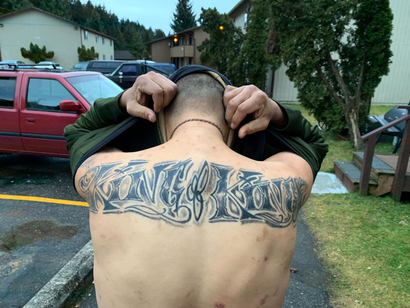 """Residents and visitors at the Chinook apartment complex in the Mendenhall Valley show tattoos they were given by Kelly """"Rabbit"""" Stephens on Sunday, Dec. 29, 2019 in Juneau, Alaska. Many said they didn't want their identities known for fear of reprisal. Stephens was killed during an early-morning altercation with Juneau Police. (Photo by Rashah McChesney/KTOO)"""