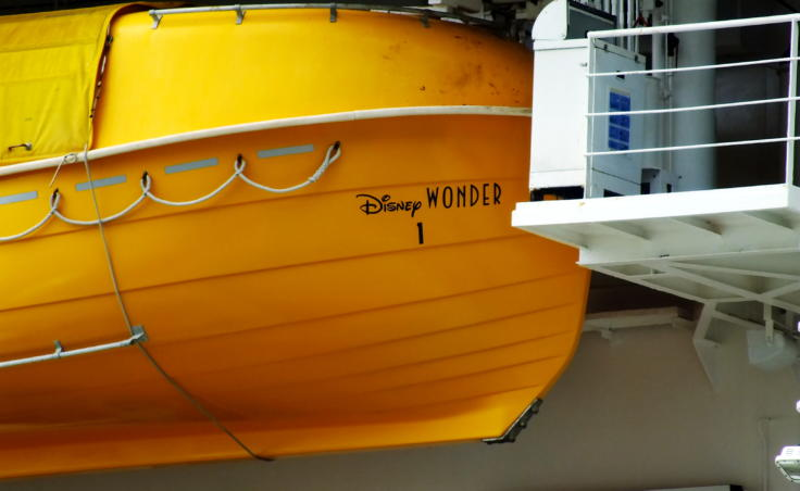 Disney had to get approval from international maritime authorities to paint their lifeboats aboard the cruise ship Disney Wonder to look like Donald Duck's feet. (Photo by Matt Miller/KTOO)