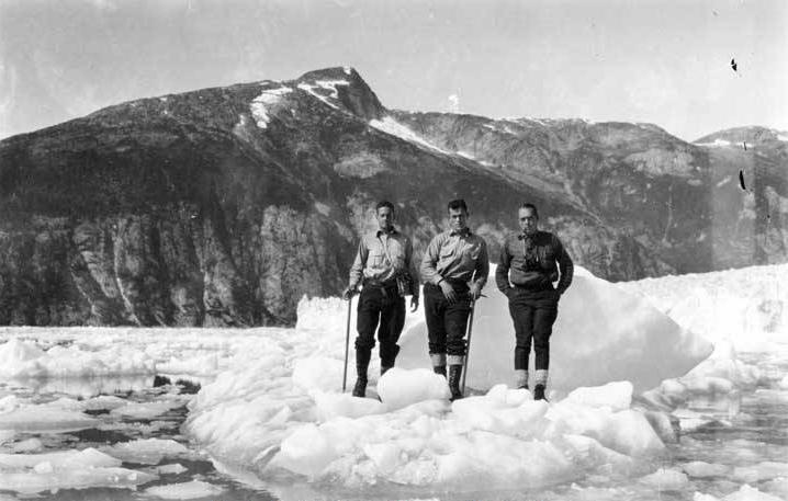 William O. Field (left to right), Benjamin S. Wood and Roscoe Bonsal standing on iceberg at Taku Glacier in 1926. (P87-2592 Alaska State Library - Winter and Pond Photo Collection)