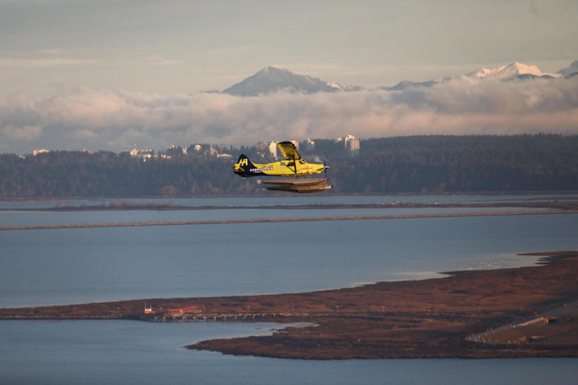 Harbour Air's e-Plane flies over the Fraser River near Vancouver, British Columbia, on Dec. 10, 2019.
