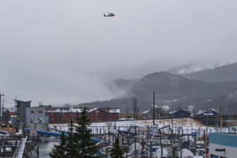 A Coast Guard helicopter hovers over Harris Harbor on Thursday, Jan. 23, 2020, in Juneau, Alaska. (Photo by Mikko Wilson/KTOO)