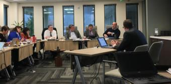 Alaska Permanent Fund Corporation trustees and executives discuss the future of the fund's earnings reserve account at a board meeting on Feb. 20 at the corporation's headquarters in Juneau. Seated, from left: chief executive Angela Rodell; trustees Corri Feige, Mary Rutherford, Craig Richards and William Moran; investment adviser Timothy Walsh; and Chief Investment Officer Marcus Frampton. Photo by Andrew Kitchenman/KTOO and Alaska Public Media