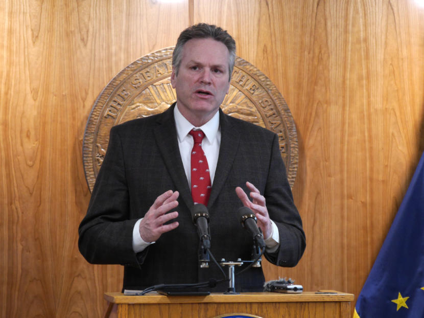 Gov. Mike Dunleavy talks to reporters at a press conference in Juneau on Feb. 19, 2020.