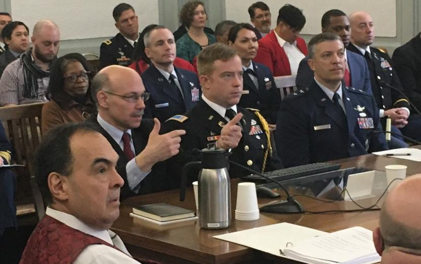 Mike Sfraga, left, wearing glasses, speaks at the Legislature's annual Joint Armed Services Committee meeting. Sfraga is the director of the Polar Institute at the Woodrow Wilson Center, a Washington, D.C., think tank. He told state lawmakers that Alaska will be at the front line of global competition over Arctic Ocean resources, in the Capitol, Feb. 6, 2020. (Photo by Andrew Kitchenman/KTOO and Alaska Public Media)