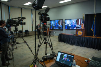 The governor's press team stands by for a press conference in the Atwood Building in Anchorage on March 30, 2020.