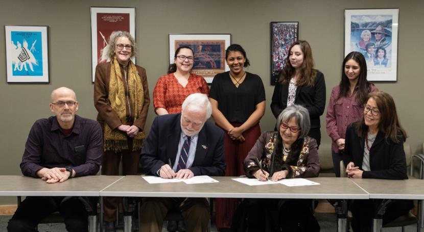 University of Alaska Southeast Chancellor Rick Caulfield and Sealaska Heritage Institute President Rosita Worl sign an agreement establishing a scholarship program to train 16 scholars in Native languages on March 4, 2020, at Sealaska Heritage Institute.