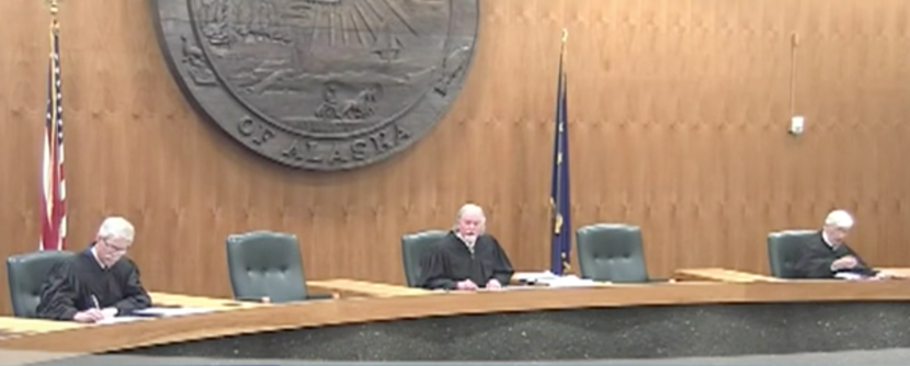 Justices Peter Maassen and Craig Stowers and retired Justice Robert Eastaugh listen to oral arguments in the case of State Division of Elections v. Recall Dunleavy. Justices Daniel Winfree and Susan Carney participated by phone, as did the lawyers. Chief Justice Joel Bolger recused himself. (Screenshot from 360 North)
