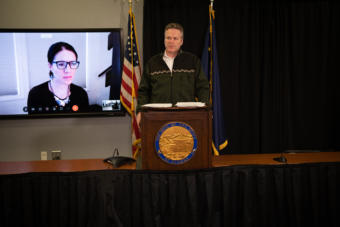 Alaska Gov. Mike Dunleavy speaks about the state's COVID-19 response from the Atwood Building in Anchorage on March 31, 2020. Also pictured: Department of Health and Social Services Chief Medical Officer Dr. Anne Zink. (Creative Commons photo courtesy Alaska Governor's Office)