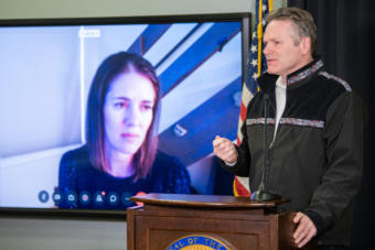 Dr. Anne Zink, Alaska's Chief Medical Officer, watches Gov. Mike Dunleavy during a press conference on the COVID-19 pandemic on April 2, 2020, in Anchorage, Alaska. (Creative Commons photo courtesy Alaska Governor's Office)
