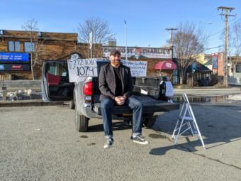 Alex JustAlex sits in the rental truck he uses as a stage for his drive-in stand up comedy show at Chilkoot Charlie's in Anchorage on April 10, 2020. (Mayowa Aina/Alaska Public Media)