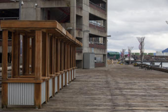A row of booths used by waterfront vendors during the summer tourist season sit empty on Saturday, March 21, 2020 in Juneau, Alaska. Juneau's Docks and Harbors Board approved a refund fees to use these booths as the COVID-19 pandemic has decimated Alaska's tourism season. (Photo by Rashah McChesney/KTOO)