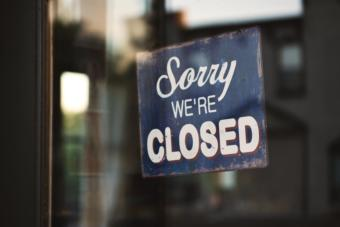 "A sign in a window saying ""Sorry we're closed."""