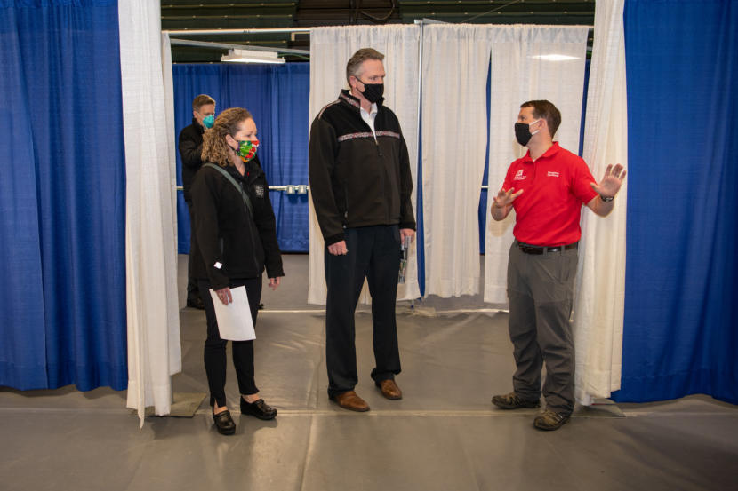 Alaska Gov. Mike Dunleavy, center, takes a tour of the Alaska Airlines Center in Anchorage on April 15, 2020.