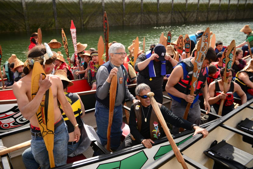 Then-Lt. Gov. Byron Mallott participates in the canoe landing ceremonies that unofficially kick off Celebration in Juneau on June 5, 2018.
