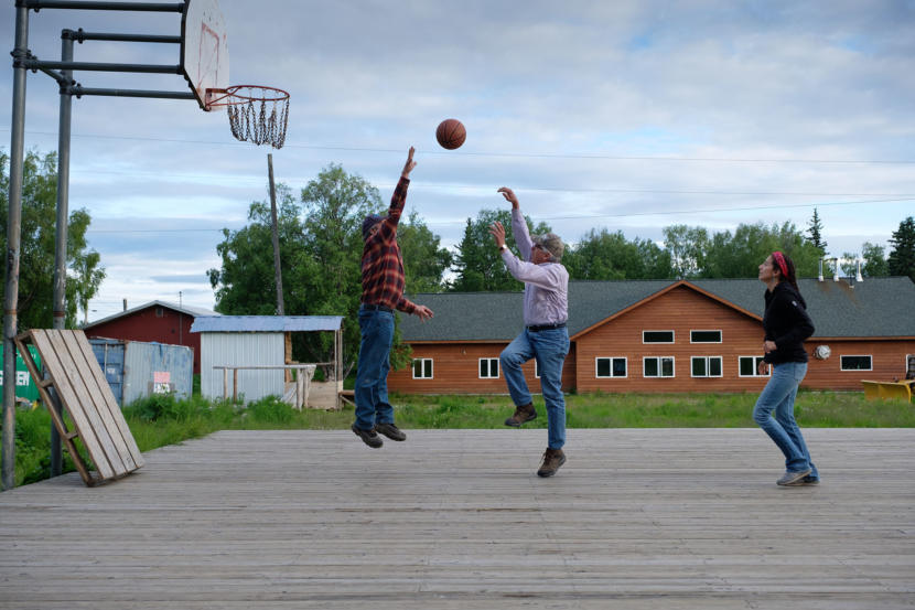 Then-Lt. Gov. Byron Mallott and Department of Fish and Game Commissioner Sam Cotton play basketball against Natasha Singh from the Tanana Chiefs Council in Grayling on June 26, 2018.