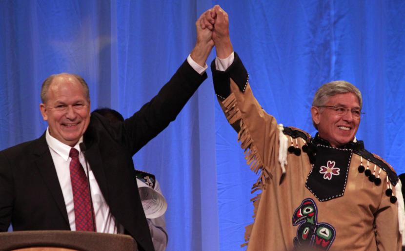 Alaska Gov. Bill Walker and Lt. Gov. Byron Mallott join hands after their inauguration on Dec. 1, 2014, at Centennial Hall in Juneau.