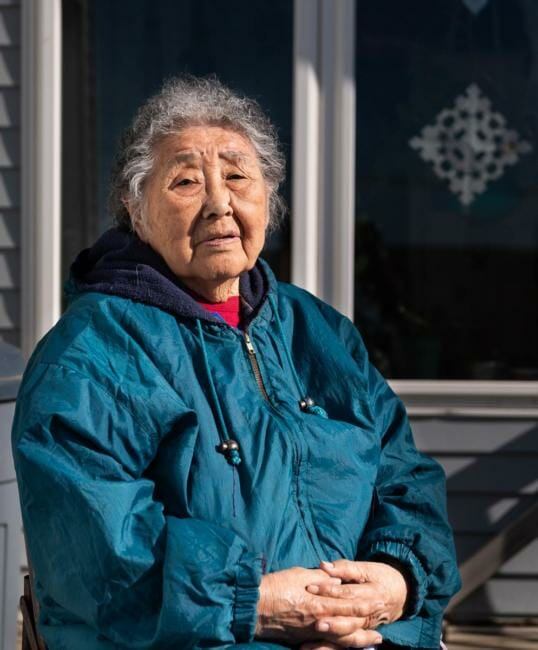Eula David outside her home in Bethel, Alaska during the coronavirus pandemic on May 7, 2020. (Katie Basile/KYUK)