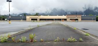 Weeds poke up in the parking lot of a former Walmart at 6525 Glacier Highway in Juneau, pictured here on June 26, 2020.