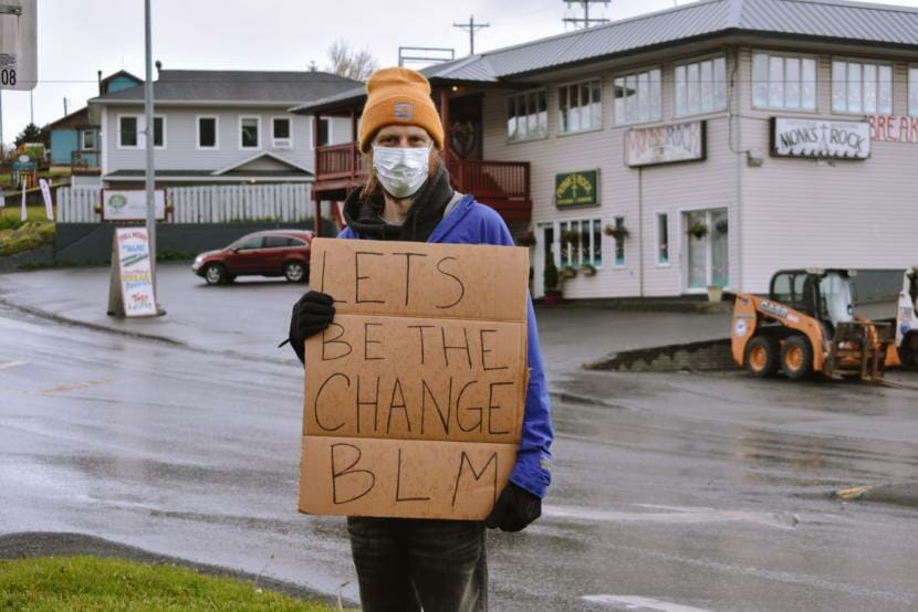 Ron Jackson holds a sign in support of the Black Lives Matter movement in downtown Kodiak. (Photo by Kavitha George/KMXT)