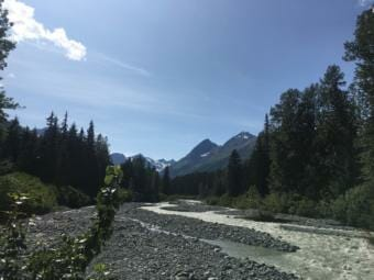 A view up Glacier Creek towards Saksaia Glacier and the mountains that hold copper-zine-silver-gold-barite deposits that Constantine Metal Resources is planning to mine. (Photo by Claire Stremple/Alaska's Energy Desk - KHNS)