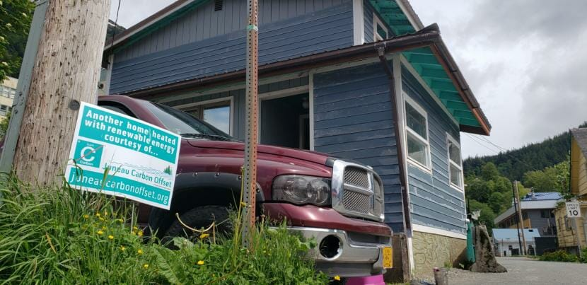 A Juneau Carbon Offset yard sign stands at the corner of Ray Lindoff's home in downtown Juneau on June 5, 2020.