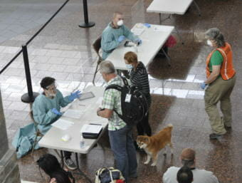 A health screening for travelers at Anchorage's airport