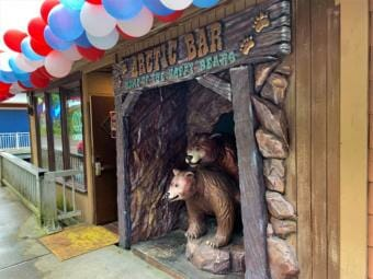 Two bear statues and balloons greet patrons at the Arctic Bar's entrance in Ketchikan.