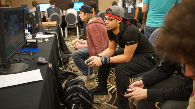 People playing games at a gaming event