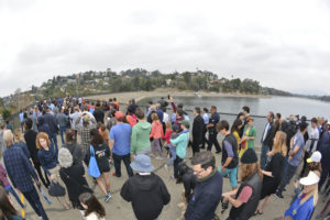 Image of a group of people gathered at Silver Lake South Dam walkway