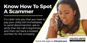 """An image of a woman holding a phone looking concerned. Text: """"Know How To Spot A Scammer"""" """"Knkow the signs to #StopScams"""""""