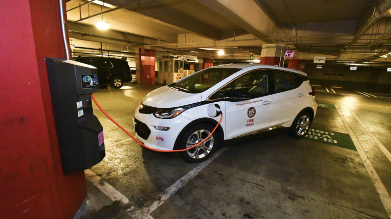 Image of Los Angeles City Fire Department vehicle connected to an EV charger at Los Angeles City Hall.