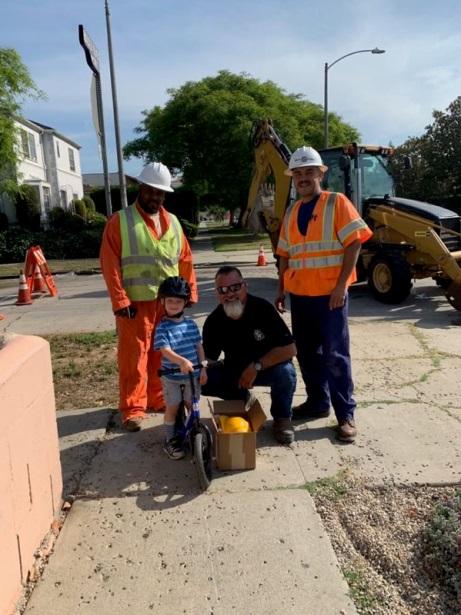 Image of LADWP crew and a neighborhood boy
