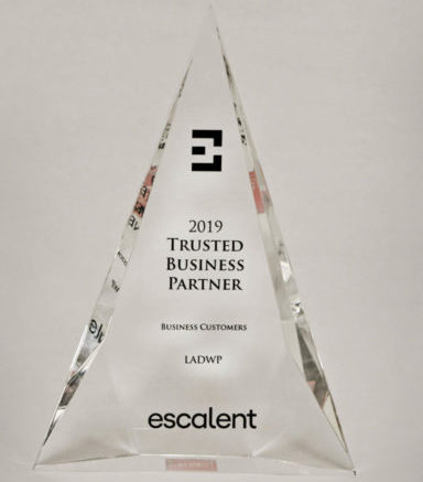 "A lucite, pyramid-shaped award that says: ""2019 Trusted Business Partner"" ""Business Customers"" ""LADWP"" ""escalent"""