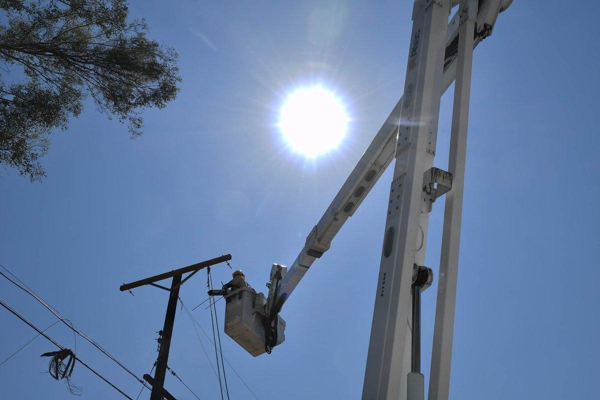 Lineworker makes repairs power lines