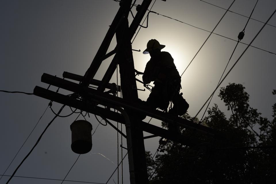 Lineworker repairing overhead power lines
