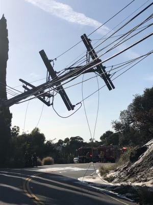image of a tilting and broken power pole
