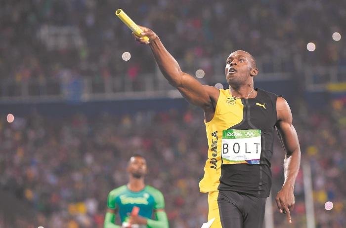 Usain Bolt se quedó con el título del mejor deportista, según L'Équipe. LA PRENSA/AFP /OLIVIER MORIN