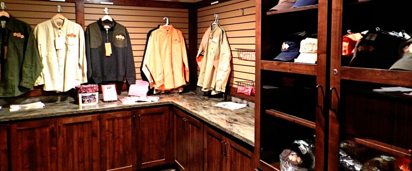 The Lazy J Grand Lodge Pro Shop hanging shirts and more from Cabela's