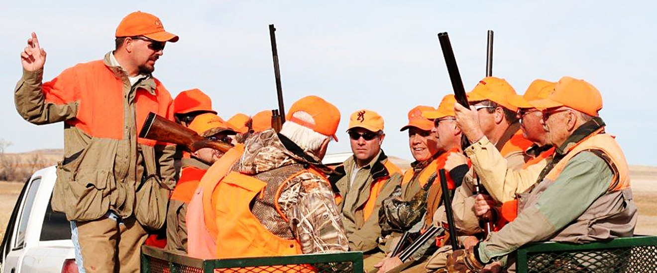 Hunter Guide and Instructor explaining to a group hunt - Lazy J Grand Lodge