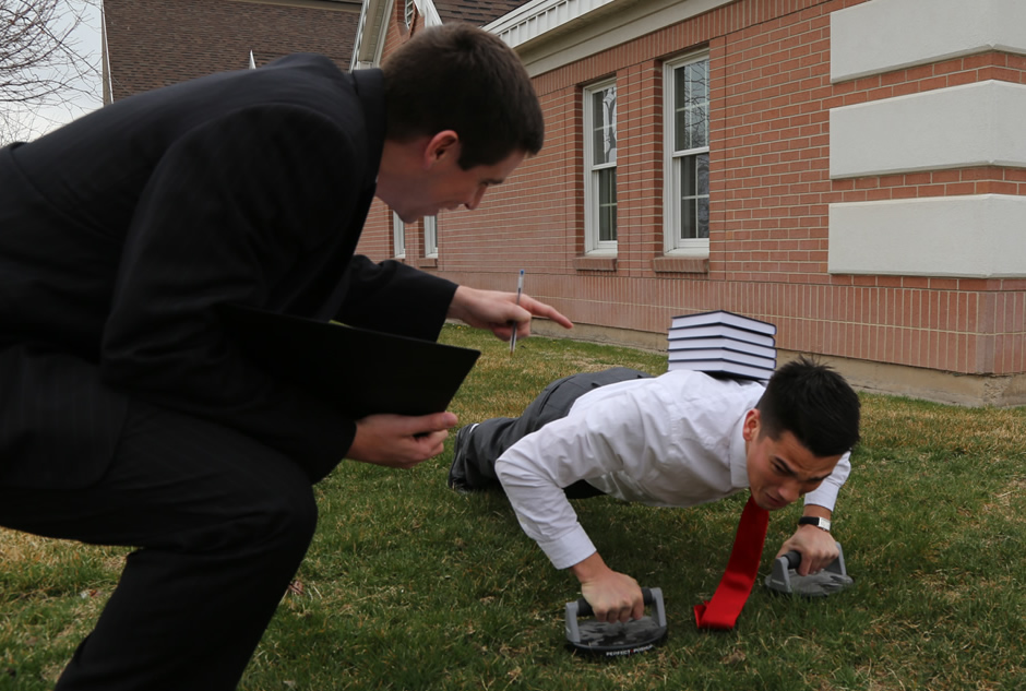 Conducting a pushup exam with a prospective missionary.