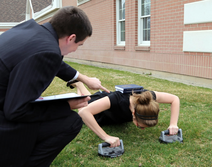 Conducting a pushup assesment with prospective sister missionary.