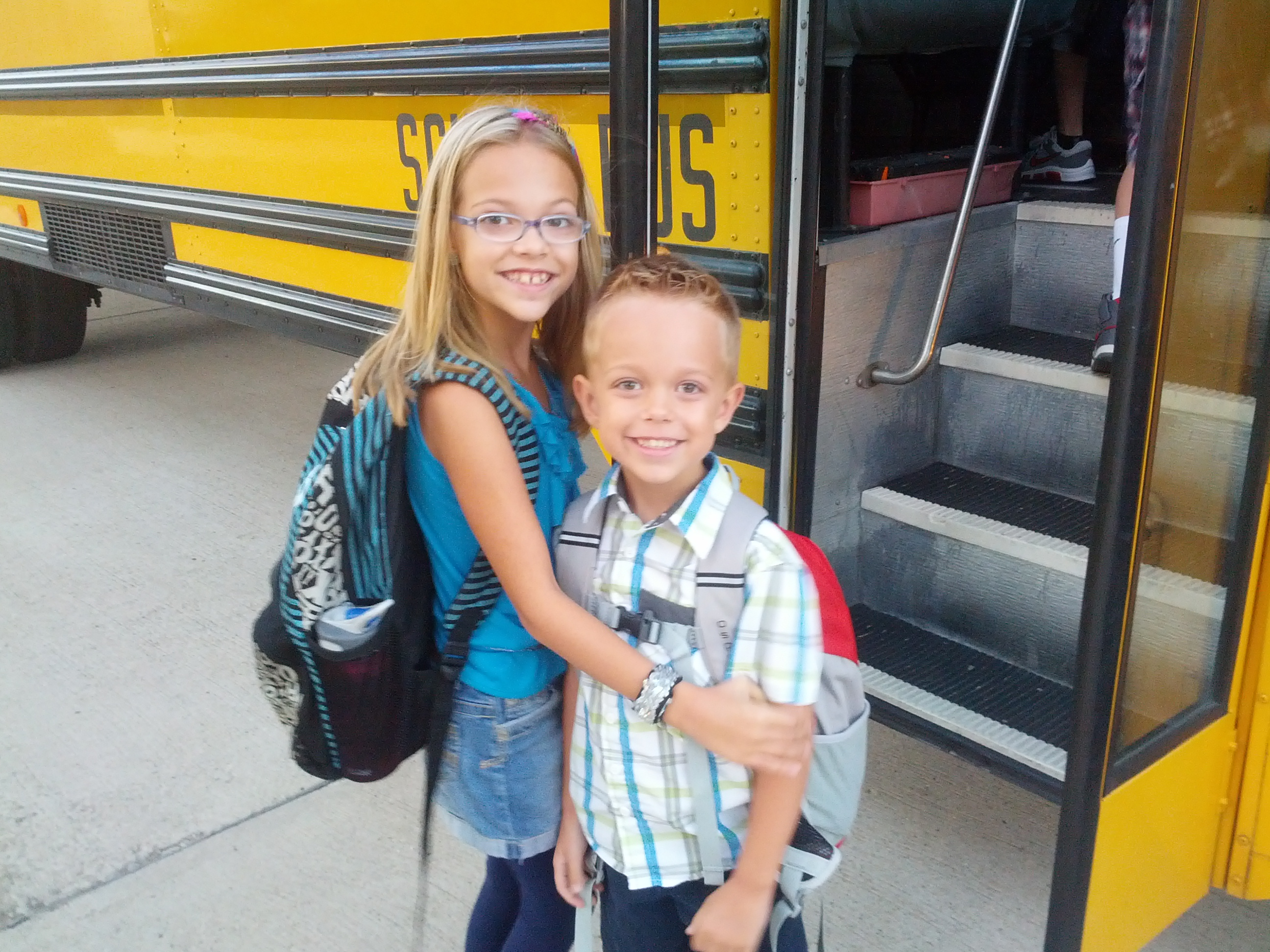 Hannah & Evan about to ride the school bus for the first time!