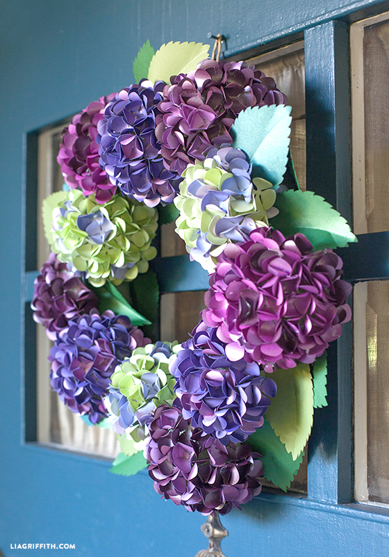 Purple and green paper hydrangea wreath on front door
