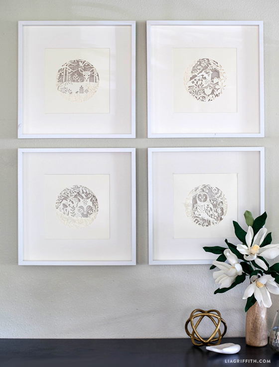 four seasons papercut woodland animal artwork in frames on wall