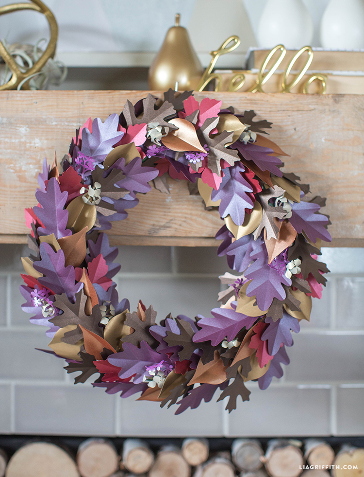 fall paper leaf wreath on mantel above fireplace
