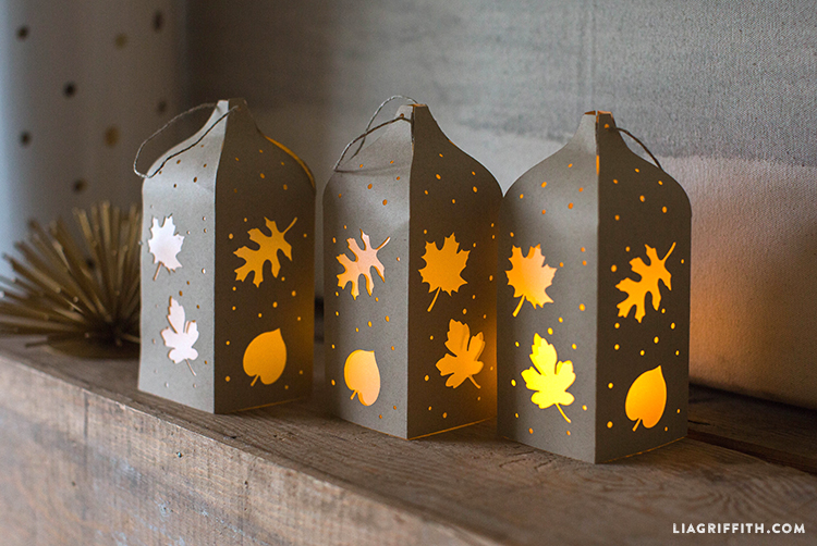 fall paper cut lanterns with leaf and acorn cutouts and LED lights