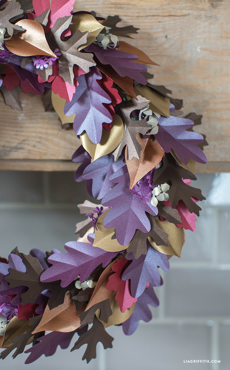 fall paper leaf wreath with purple, gold, brown, and red paper