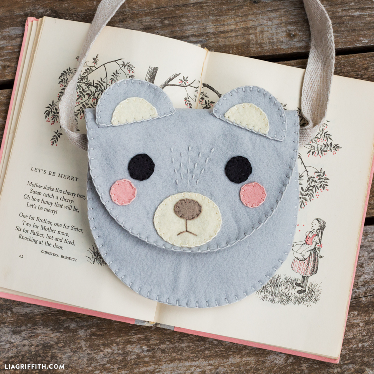 DIY bear felt bag on open book