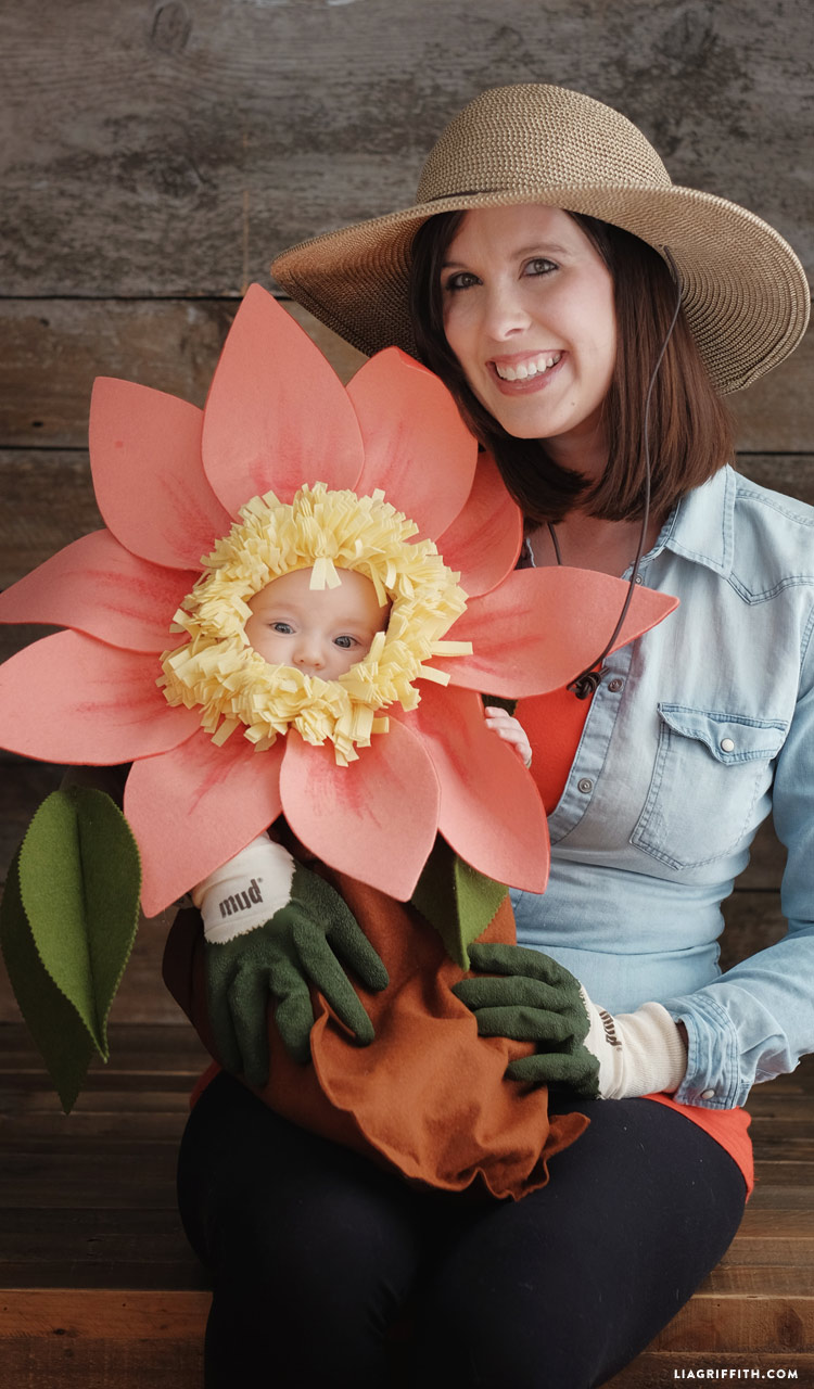Mom in gardener costume with flower baby Halloween costume